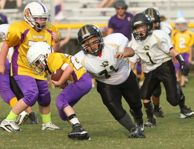 Diego Cornado getting after a Fentress County Bulldog in the Tigers game Saturday.