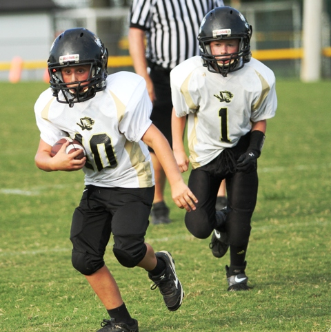 Conner Crabtree runs against the stout Fentress County defense Saturday.