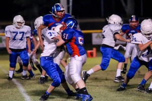 The Saints' Matthew Agee locked up with a Gordonsville player.