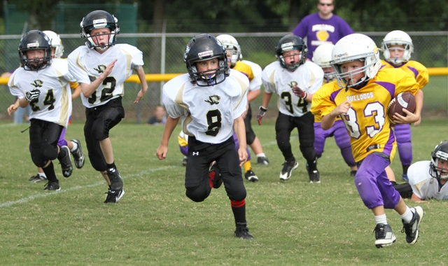Owen Snipes, Kaleb Spears and Seth Cantrell track down a Fentress County Bulldog in the Peewee Tigers Black Team scrimmage Saturday.