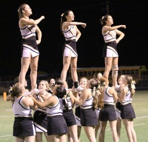 The Tiger cheerleaders helped build up their football team all night last Friday night.