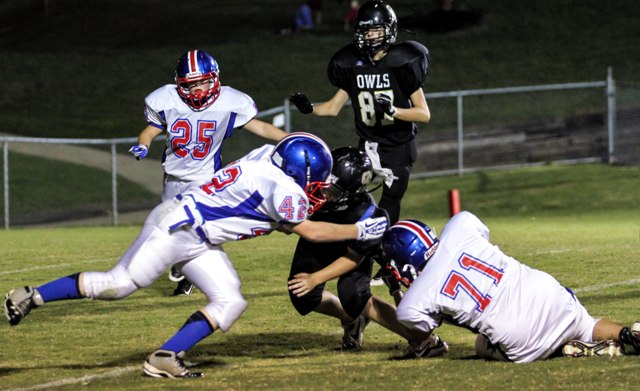 Garret Driver and Kelby Melton combine for a tackle Thursday night.