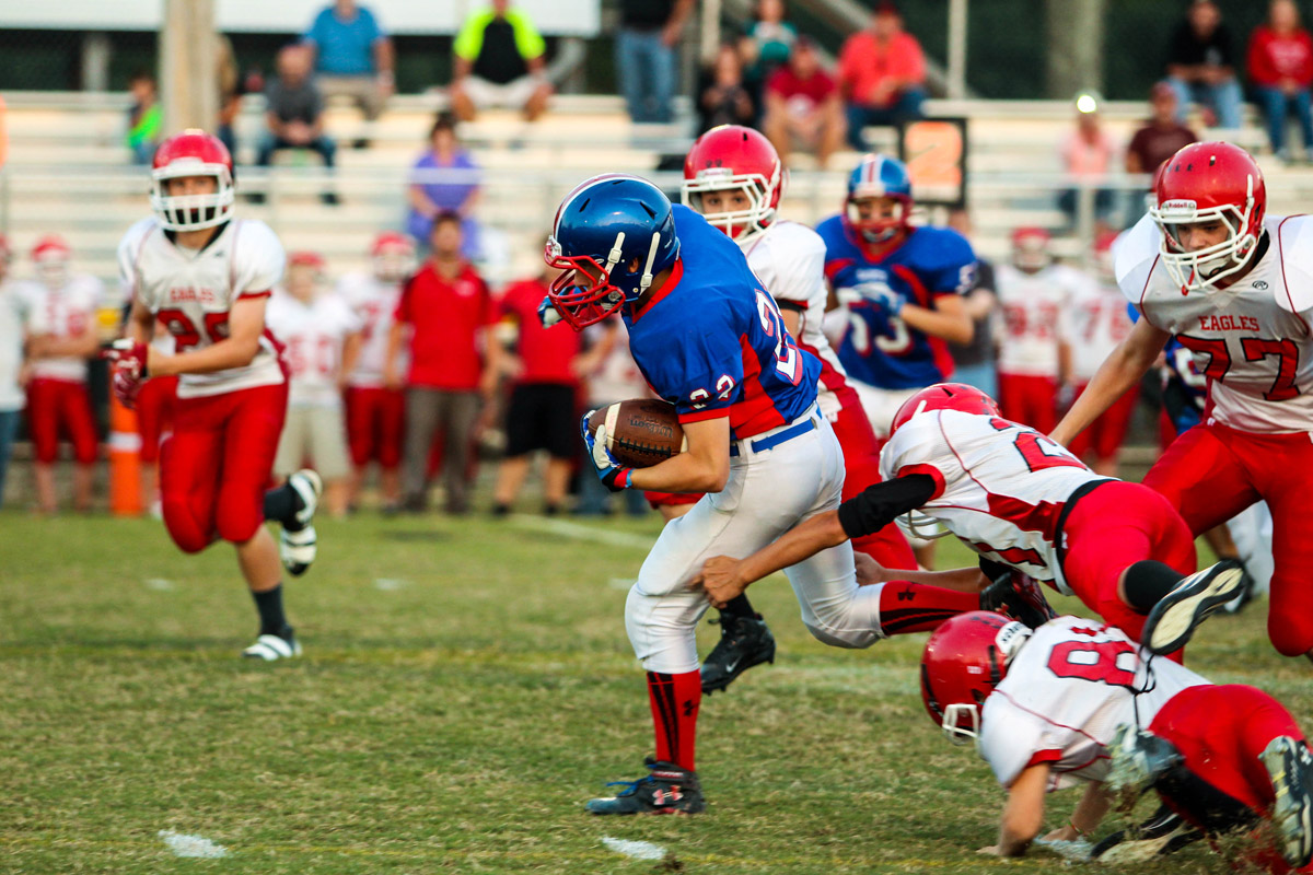 Paxton Butler gets a first down in DeKalb's game vs. Westmoreland.
