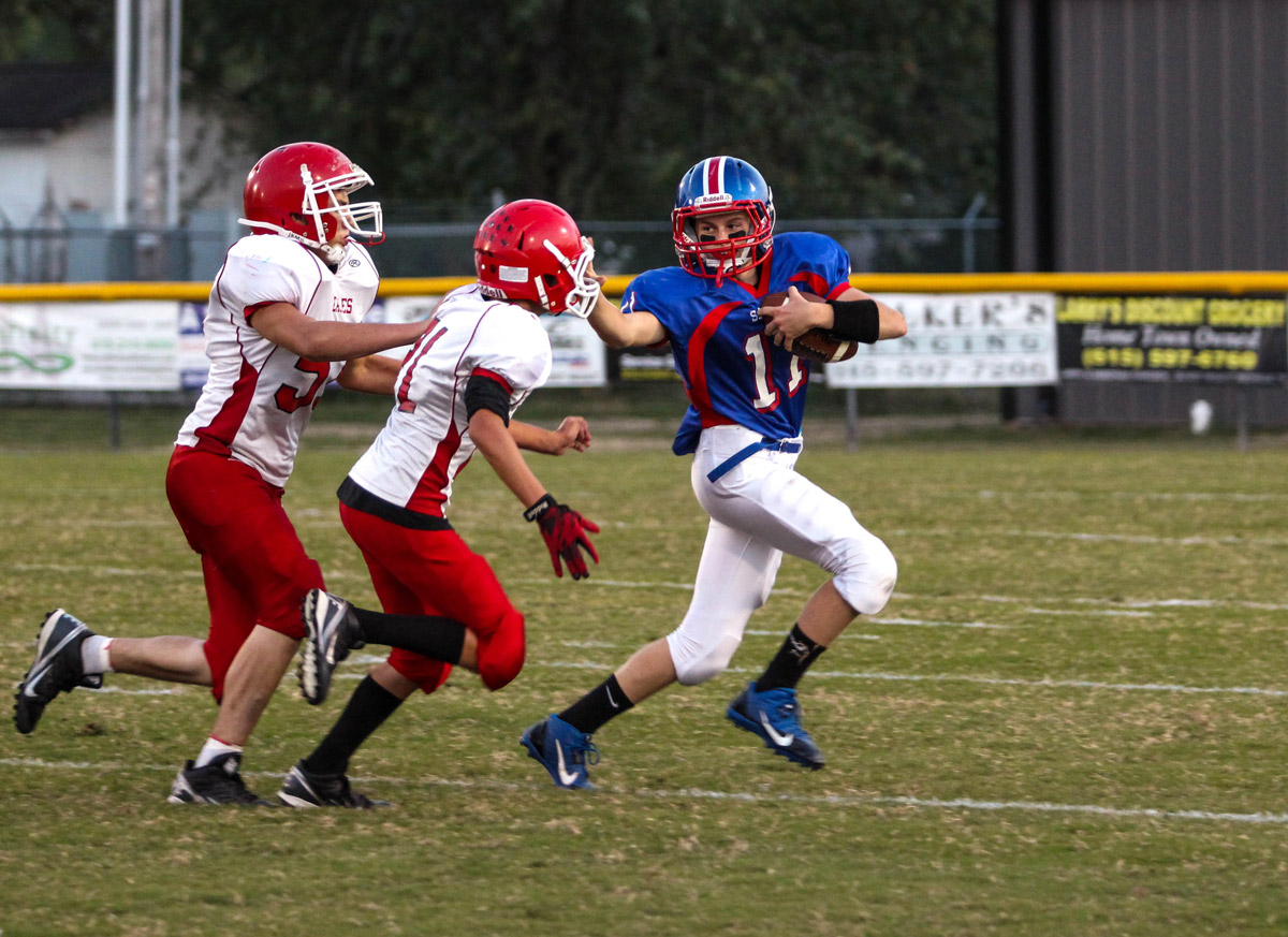 Tyler Cantrell breaking away from Westmoreland's defense in DeKalb Middle's homecoming Thursday night.