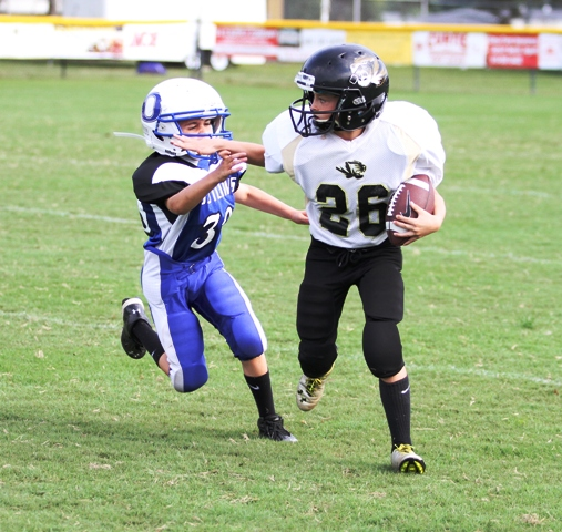 Isaiah Bly eluding a tackle Sunday.
