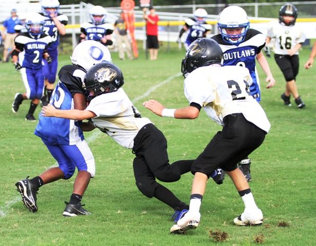 Joshua May making a big tackle.