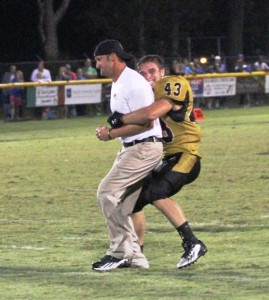 Rickey Spare grabs Tiger Head Coach, Steve Trapp after DeKalb's huge win against Livingston Academy.