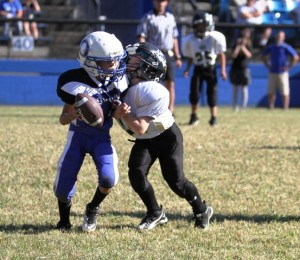Wesley Kent got a sack in the Peewee Tigers' game at Livingston Sunday.