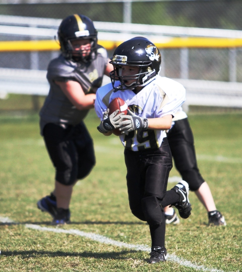 Matthew Usrey scored a touchdown on the Tigers first play from scrimmage Saturday.