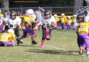 Peewee quarterback, Briz Trapp, scored a touchdown in DeKalb's victory over Fentress County Saturday.