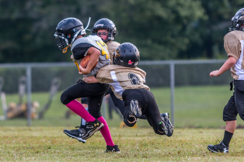 Andrew Vickers makes a tackle