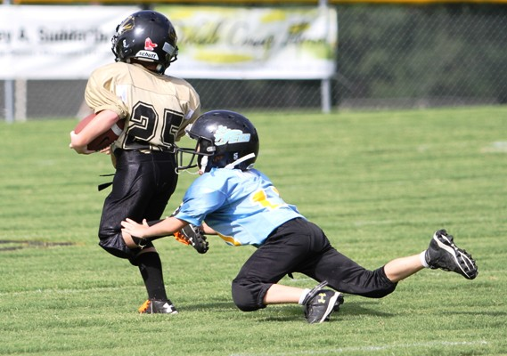 Peewee Quarterback Maddox Hale ran for a touchdown in Saturday's B Team game against Crossville