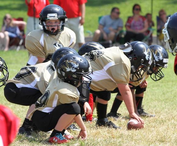 Peewee B quarterback, Maddox Hale surveys the landscape in Saturday's Jamboree