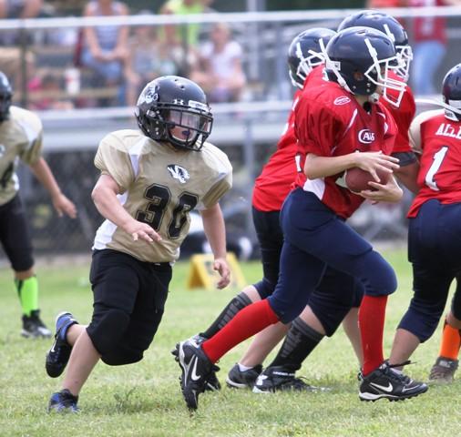 Brayden Givens tracks down the Cookeville quarterback last Saturday.
