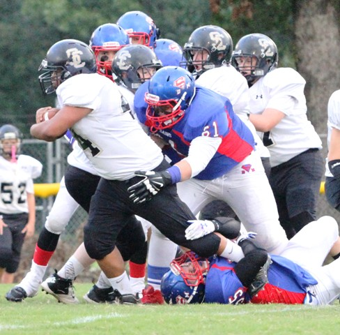 Noah Gill takes down Smith County fullback, Fabian Torres.