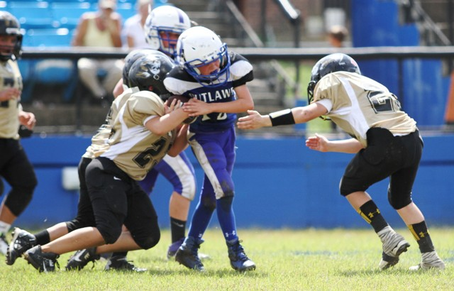 Silas Cross and Ty Panker combine for a tackle Saturday.