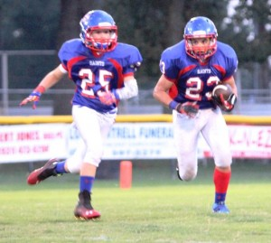 Tyler Bundy gets help from Noah Martin in Thursday night's game vs. Smith County