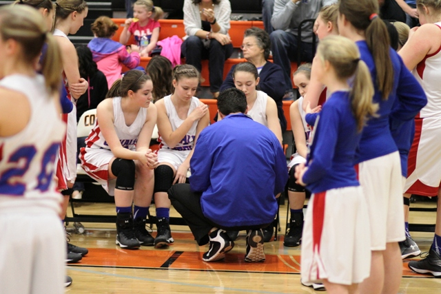 Lady Saints Head Coach, Josh Agee, talks to his team before the James C. Haile Championship game Saturday night.