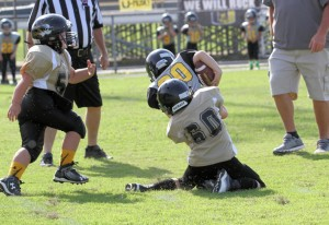Blaine Atnip helps force a fumble against Upperman Saturday.